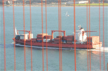 http://asset1.cbsistatic.com/cnwk.1d/i/tim/2012/05/24/GGB_cargo_ship_through_cables_1_610x405.jpg