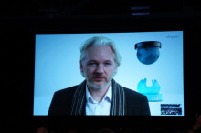 http://core0.staticworld.net/images/article/2014/03/assange_sxsw-100249541-large.jpg