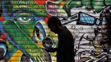 http://o.aolcdn.com/hss/storage/midas/2319a3c55d89151f2c565465394b7dba/202487985/smartphone-graffiti-eyes-ap-photo.jpg